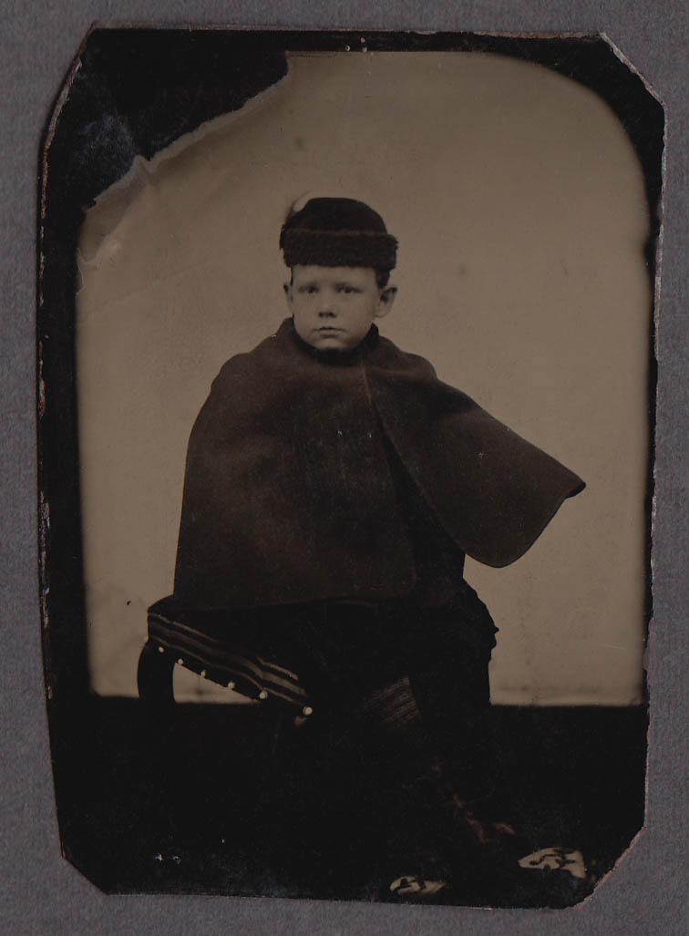 Image for Seated boy in wool hat, cape & boots studio tintype 1860s