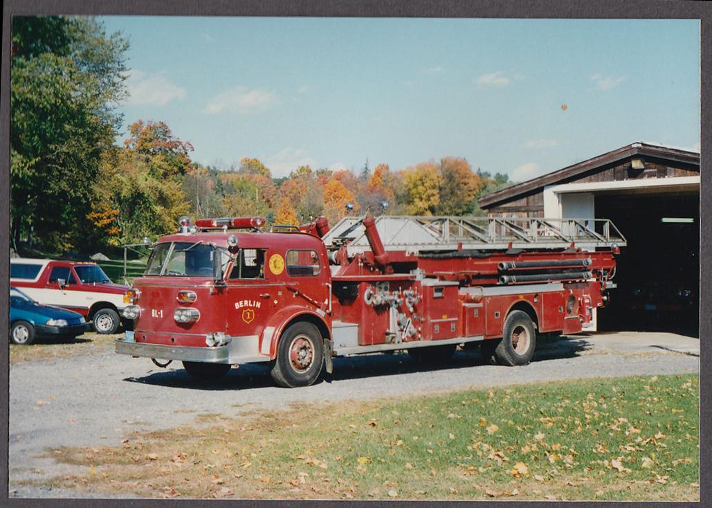 Image for Berlin MA FD Ladder Truck Engine #1 fire truck photo at garage