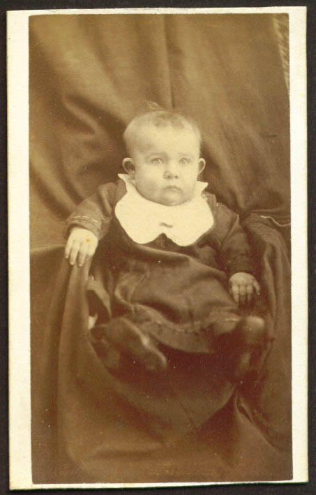 Jug-eared seated baby with bib CDV place unknown