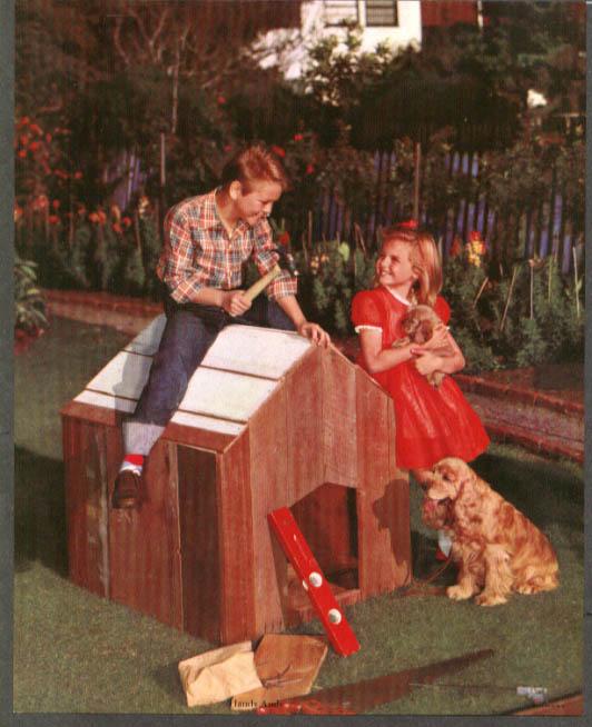 Boy builds doghouse for girl with cocker spaniels calendar sample insert 1950s