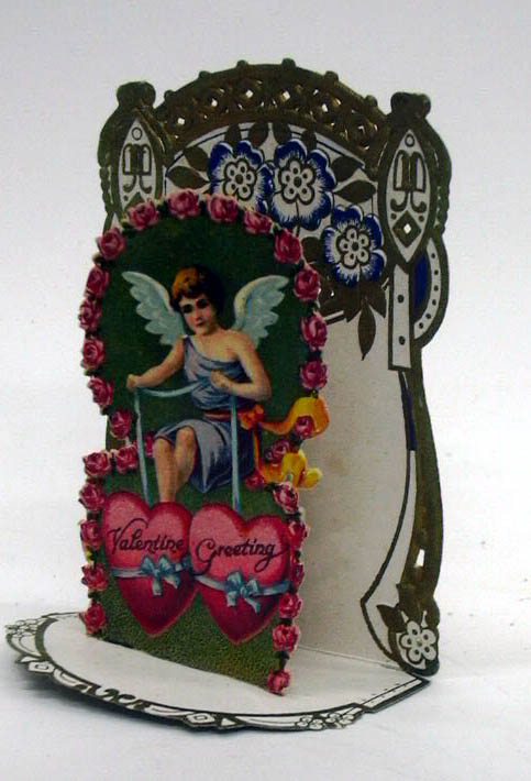 Image for Valentine Greetings cupid dangles two hearts 3-D foldout Valentine ca 1910s