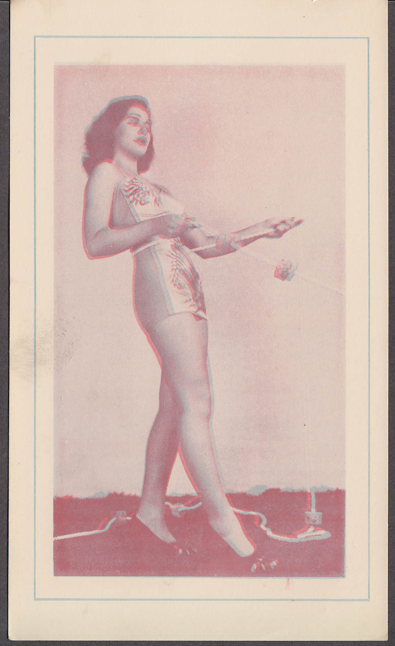 3-D Bathing Beauty Card girl in decorated 1-piece swimsuit pulls rope 1940s
