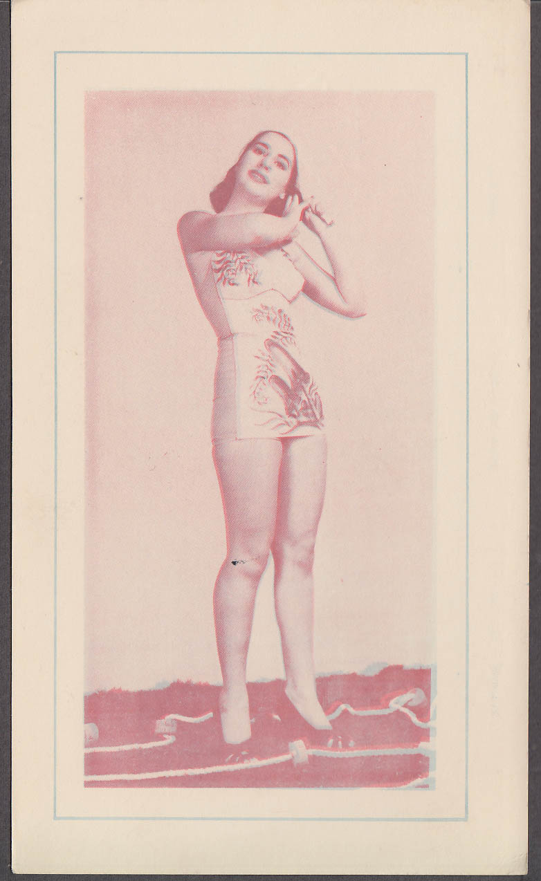 3-D Bathing Beauty Card girl in decorated 1-piece swimsuit fixes hair 1940s