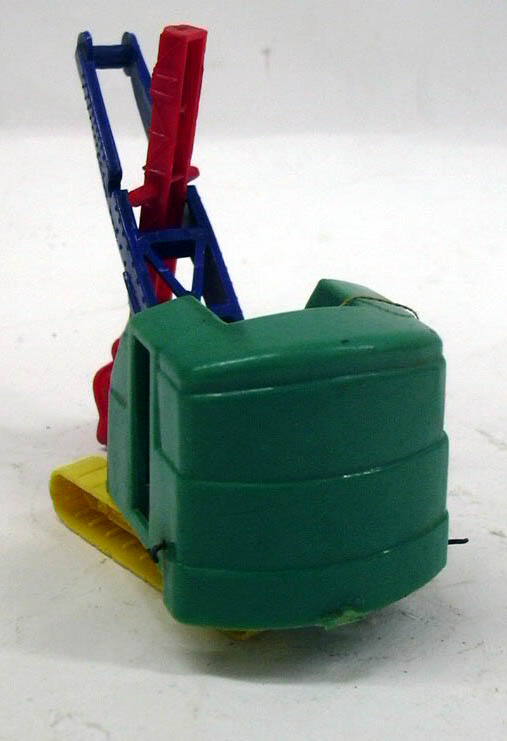 "Banner plastic steamshovel needing restringing 3"" tall"