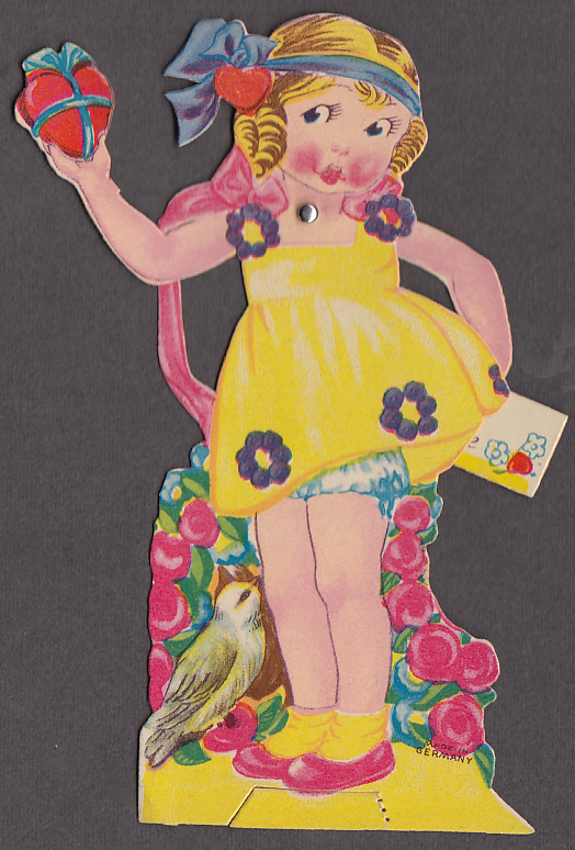 Blonde little girl with heart in hand mechanical Valentine card 1930s