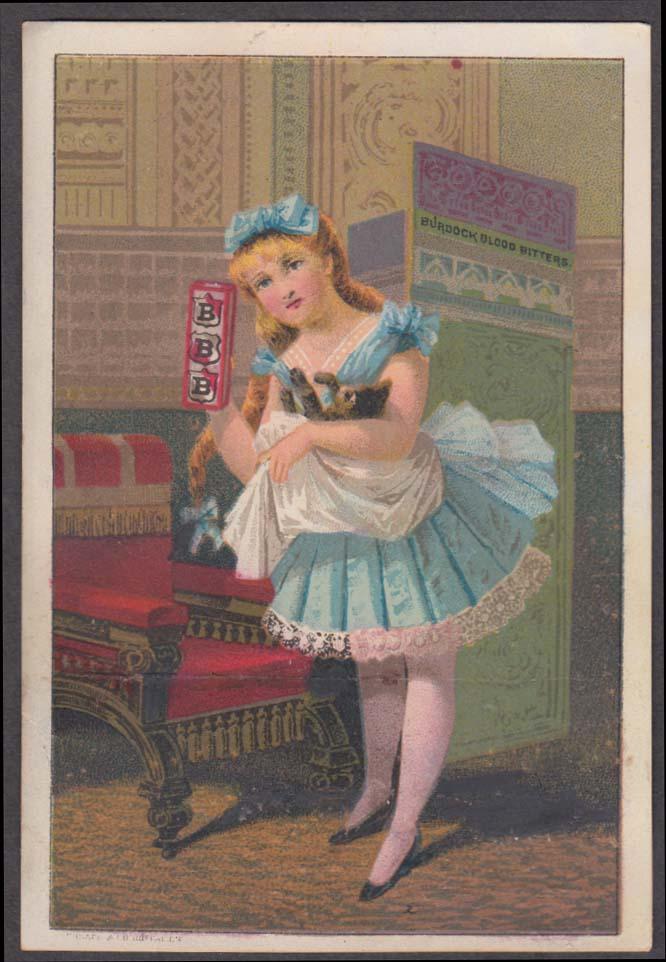 Burdock Blood Bitters trade card 1880s blonde girl in blue swaddles a cat