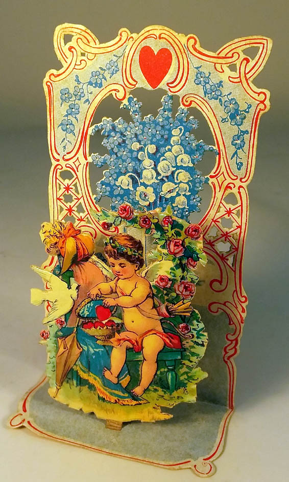 Image for Valentine stand-up card Cupid & dove wrap hearts in basket ca 1910s