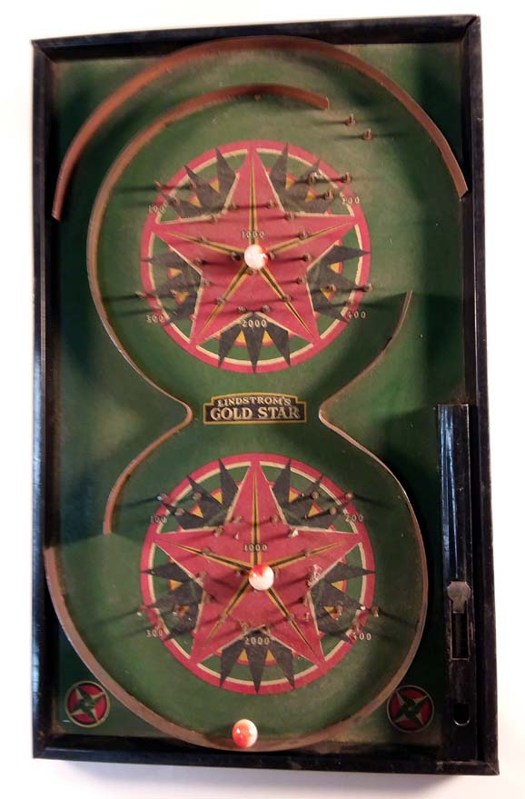 Lindstrom's Gold Star Pinball game board & three marbles ca 1930s