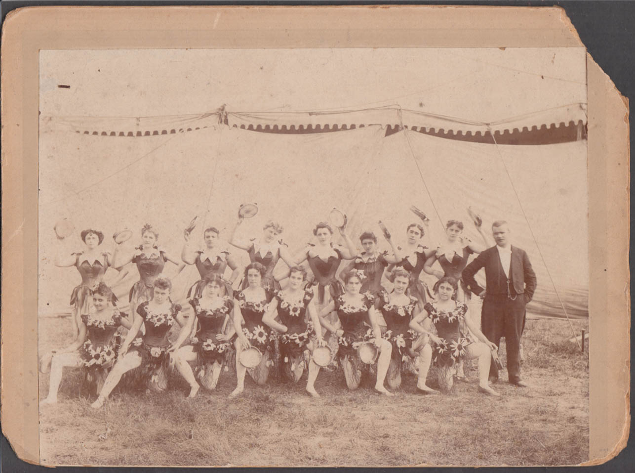 16 female circus performers: a tambourine troupe photograph ca 1900