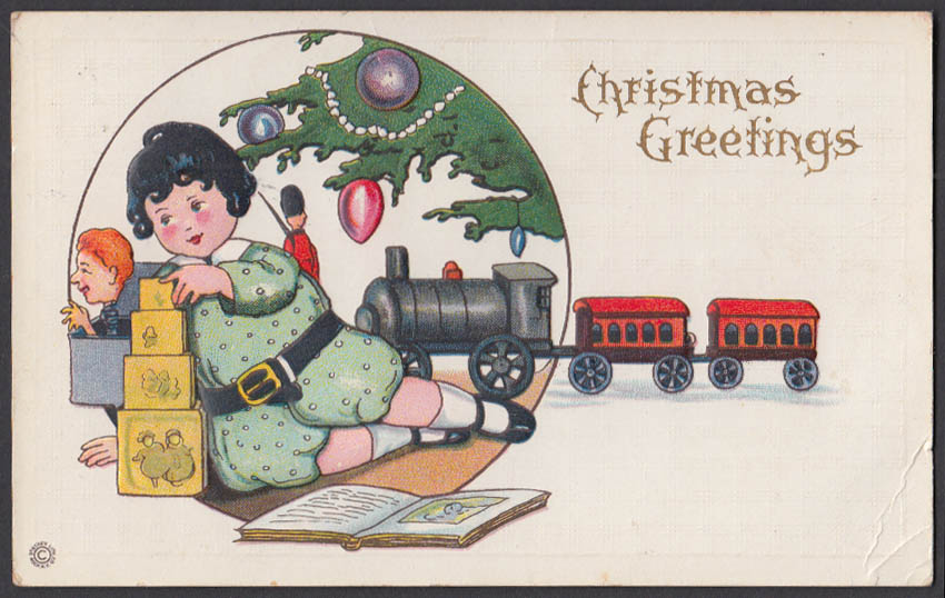 Image for Christmas Greetings postcard 1910 child under tree toy train & blocks