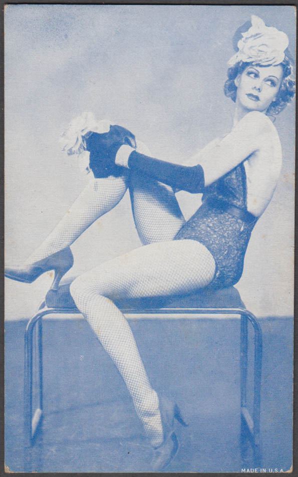 Seated blonde flowered hat fishnet stockings heels pin-up arcade card 1940s