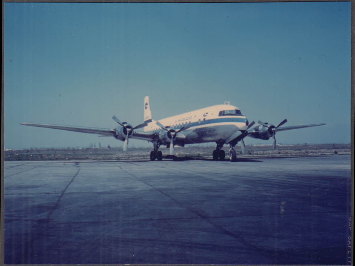 Image for Ladeco Lnea Area Del Cobre Airline Douglas DC-6 color tarmac snapshot ca 1950s