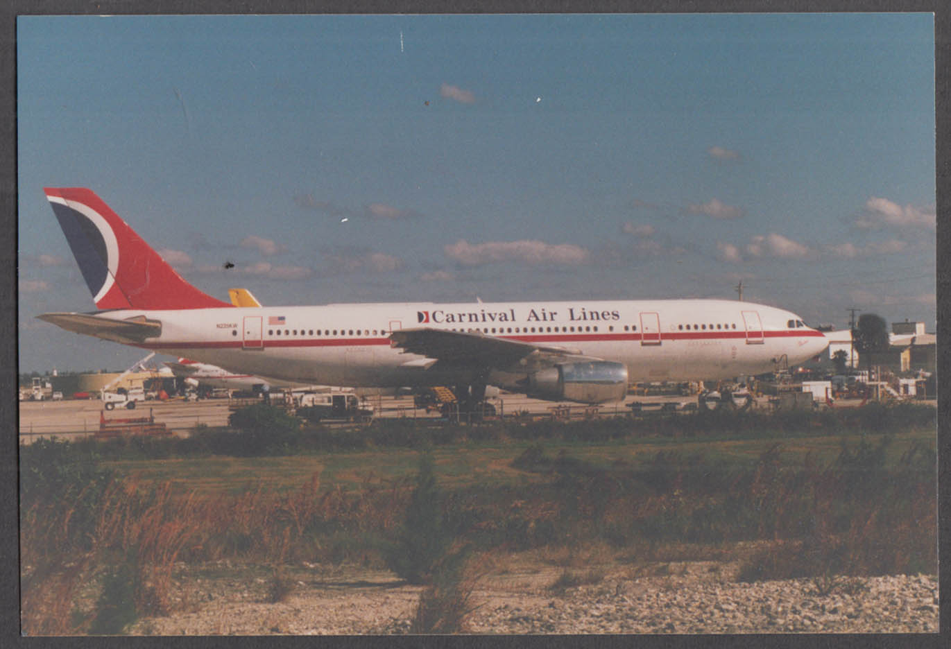 Image for Carnival Air Lines Airbus A300B4 N225KW tarmac snapshot color photo ca 1990s