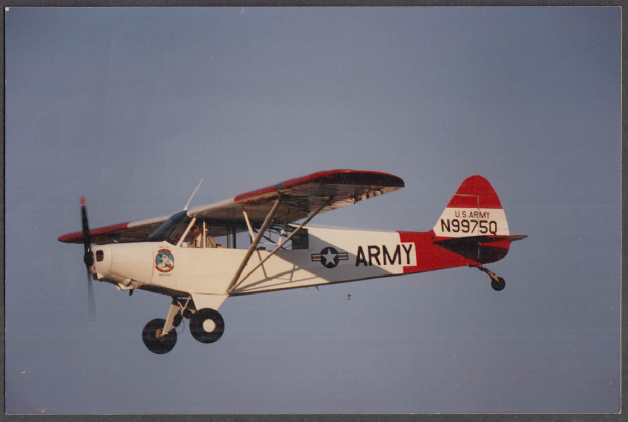 Image for US Army Piper L-4 Grasshopper N9975Q in flight color photo ca 1970s