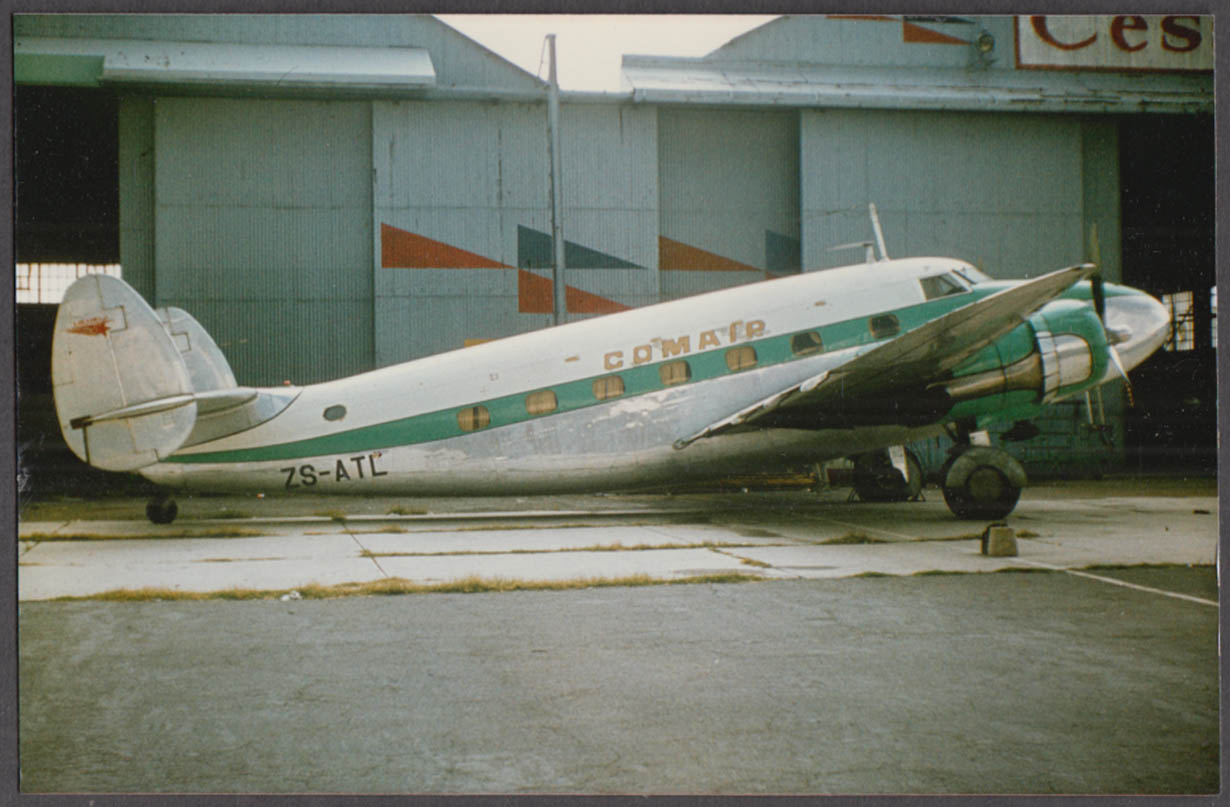Image for Comair Ltd Lockheed 18-08 Lodestar ZS-ATL parked outside hangar color photo
