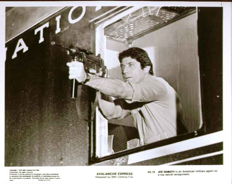 Joe Namath w/ gun: Avalanche Express 1979 8x10 still 19