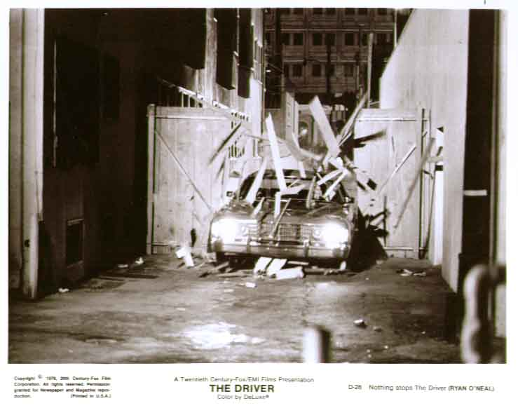 Car smashing through fence: The Driver 8x10 still 28