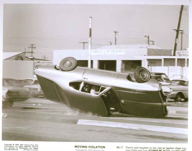 Car flipping over: Moving Violation 1976 8x10 still 17