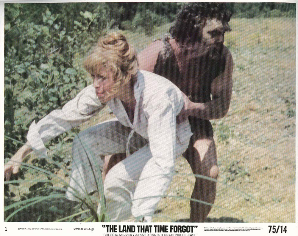 Image for Susan Penhaligon being grabbed Land That Time Forgot lobby card 1974