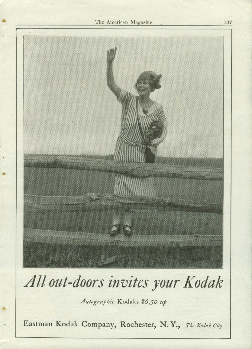 All out-doors invites your Kodak ad 1923 girl on split-rail fence