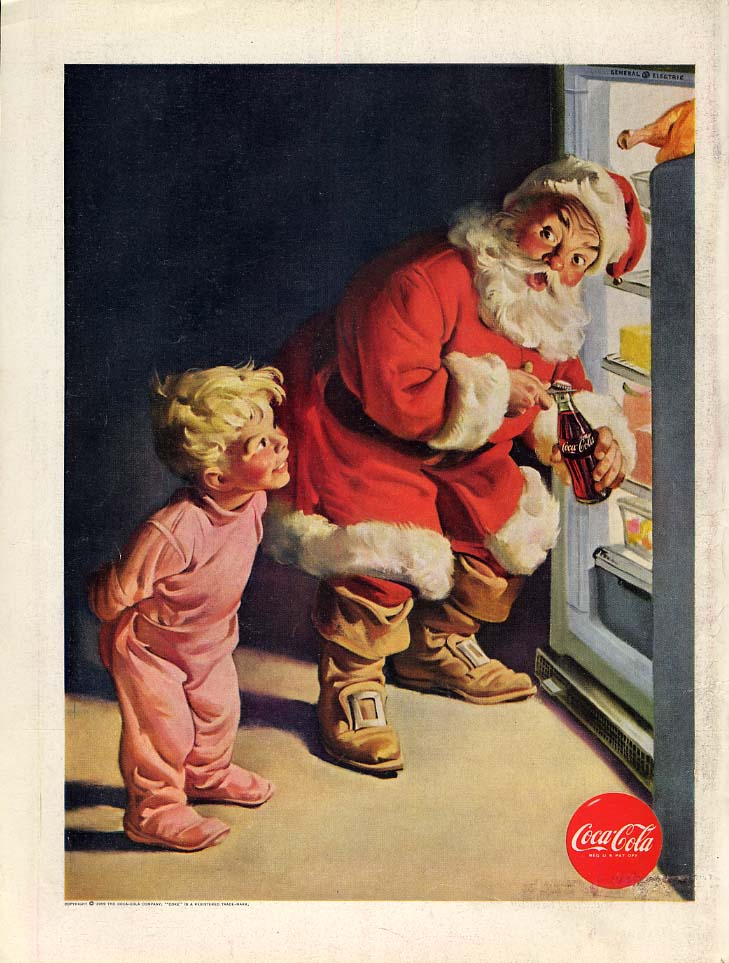 Boy in sleeper catches Santa Claus getting Coca-Cola from fridge 1959  L