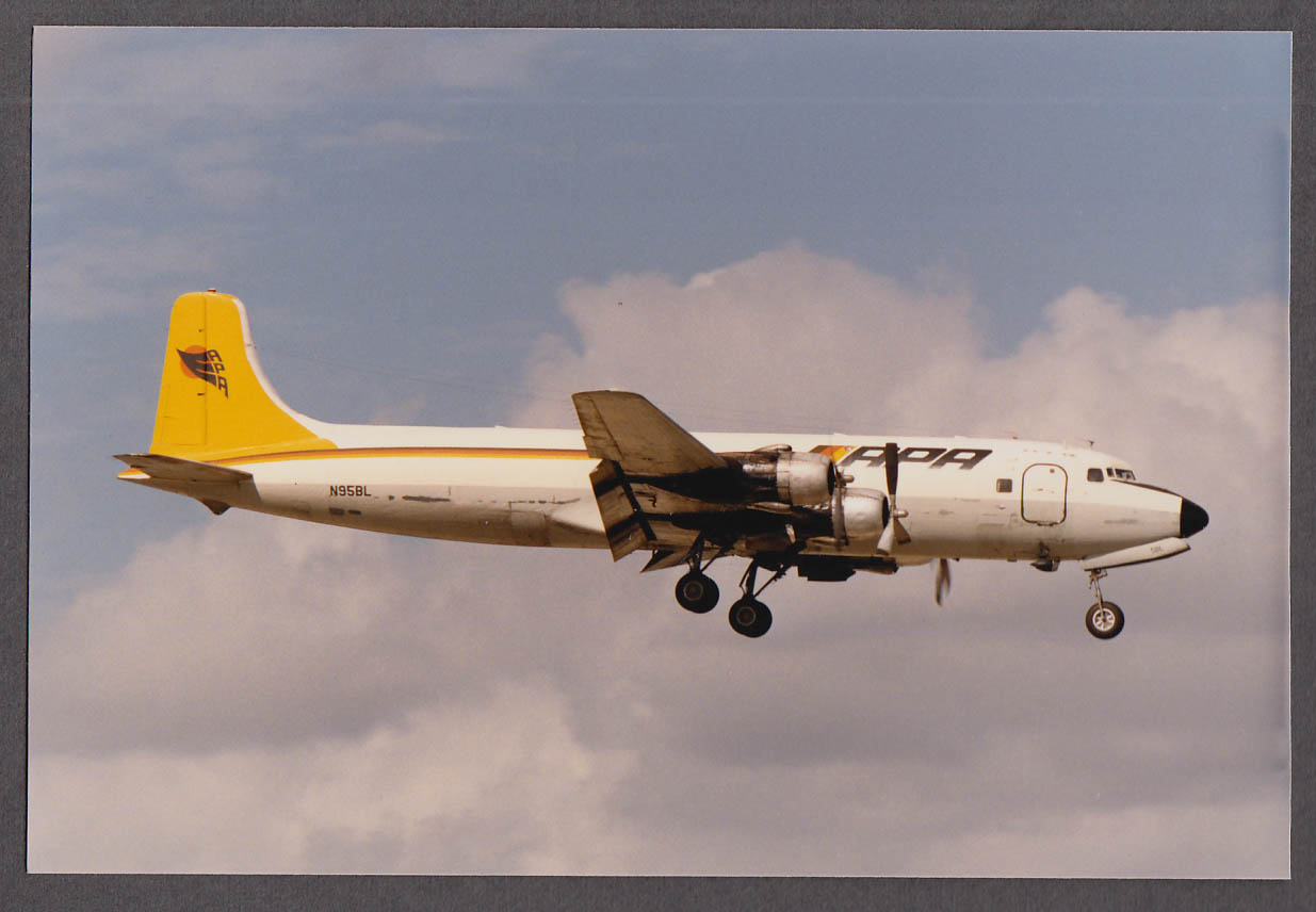 Image for APA Airlines DC-6 N95BL landing color photo ca 1970s