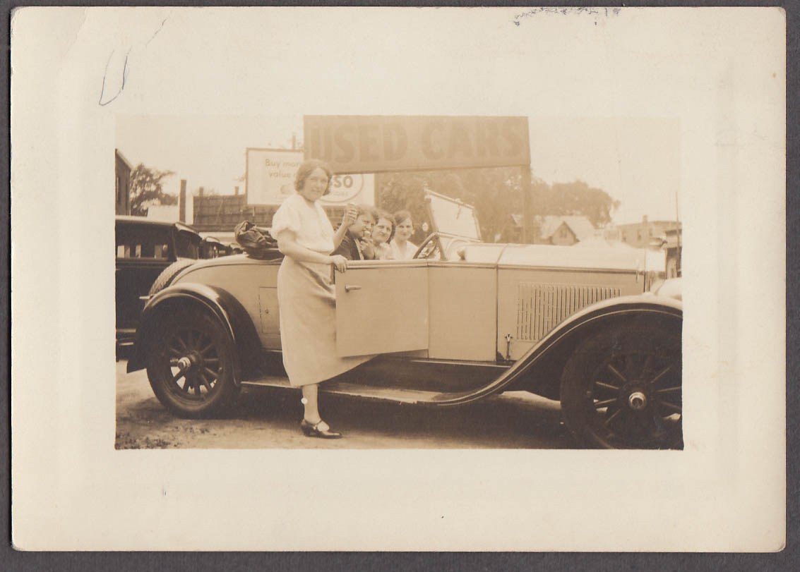 Image for Four women eating ice cream cones in Used Car Lot roadster photo ca 1930s