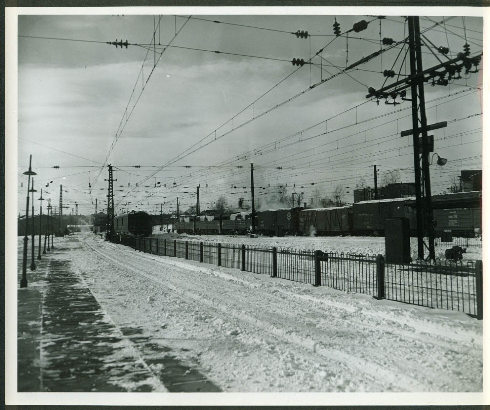 New York New Haven & Hartford RR Alco A-B-A & freight in snowy yard 1950s