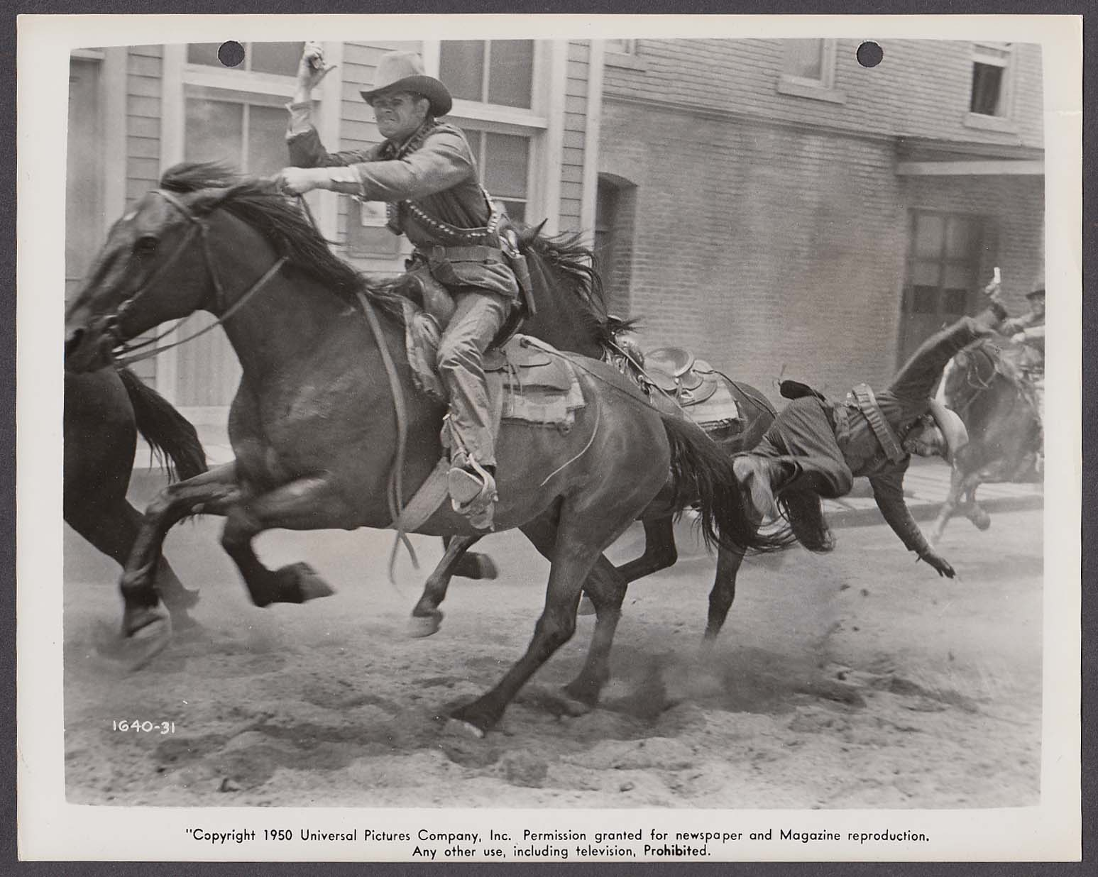 Action scene in Kansas Raiders 8x10 photo 1950 #31