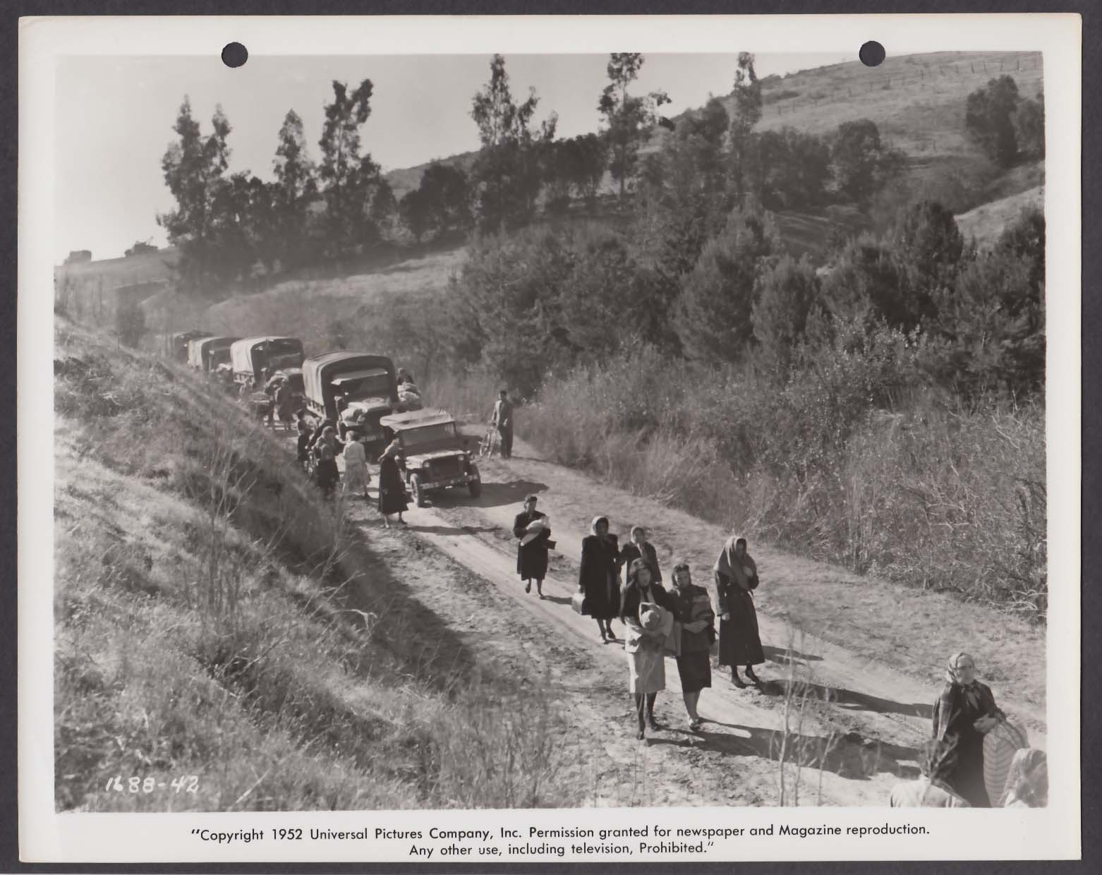 Refugees & army trucks in Red Ball Express 8x10 photo 1952