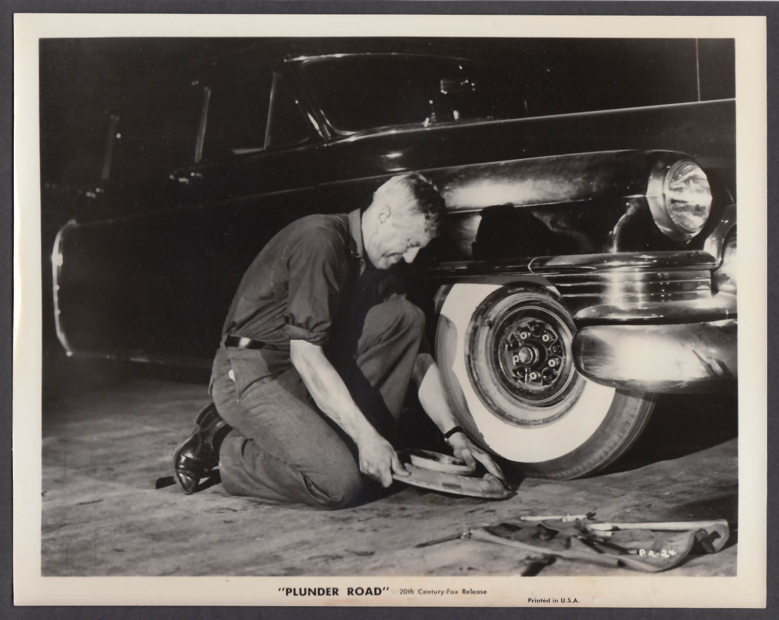 Image for Gene Raymond repairing car Plunder Road 8x10 publicity photo 1957