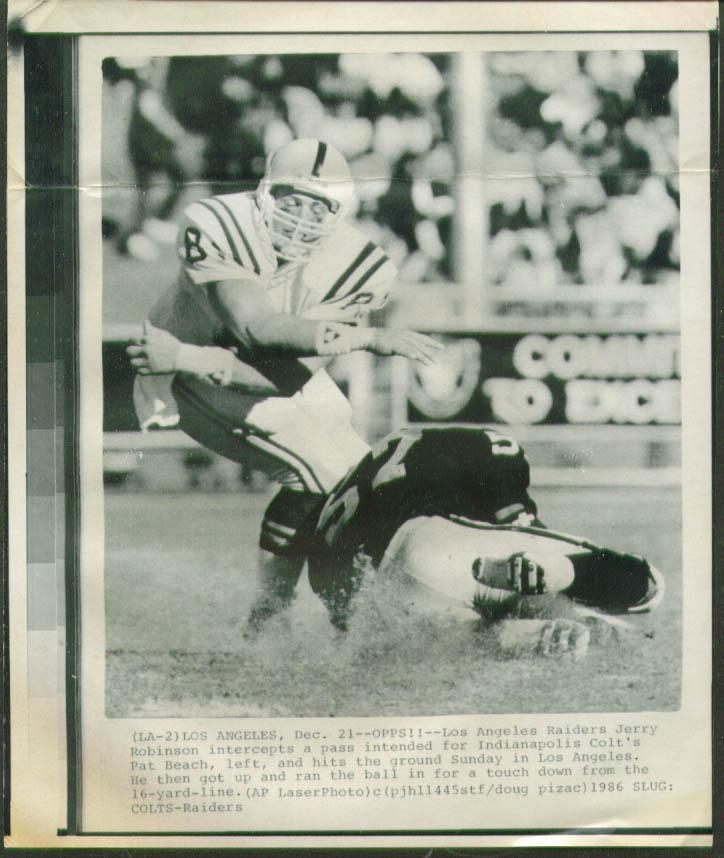 Raiders Robinson intercepts pass to Colts Beach pic '86
