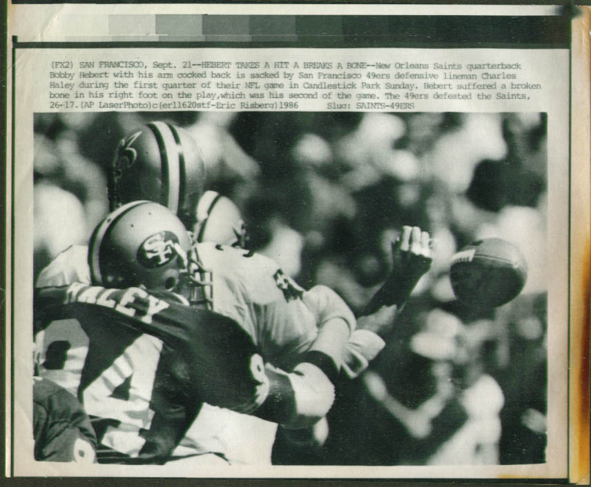 49ers Charles Haley stops Saints QB Hebert photo 1986