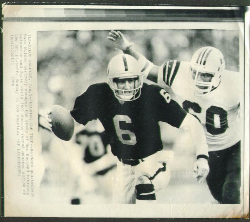 Patriots DE Veris chases Raiders QB Wilson photo 1986