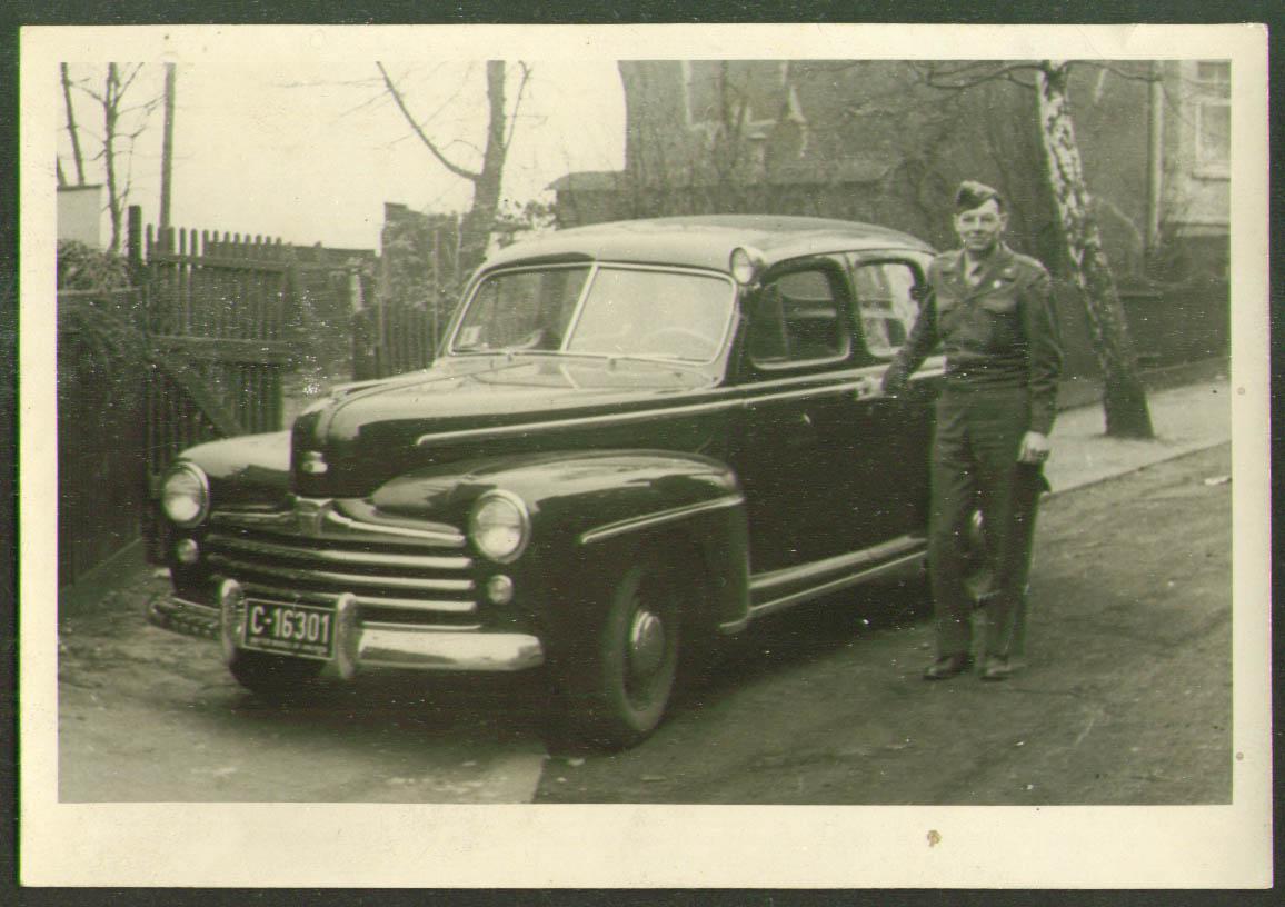 1946 Ford Staff Car & man in uniform RPPC