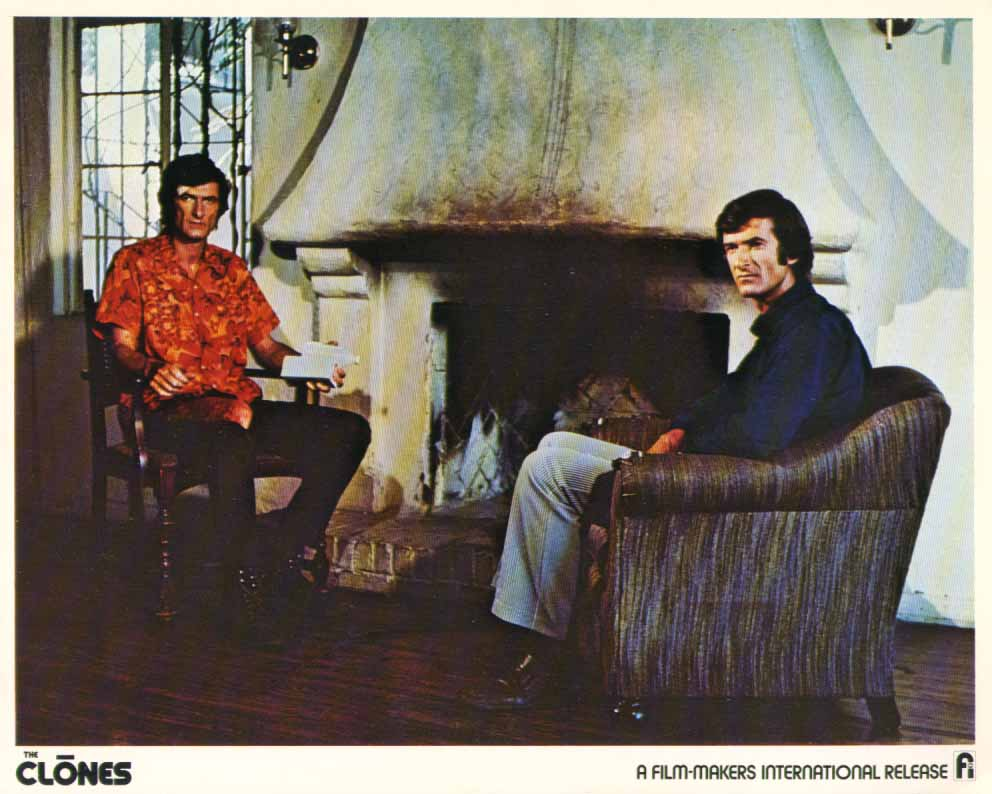 Image for Michael Greene sitting at fireplace The Clones 1973 8x10