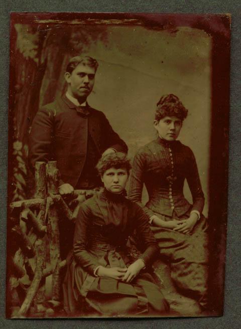 2 women & man rustic fence studio tintype ca 1860s