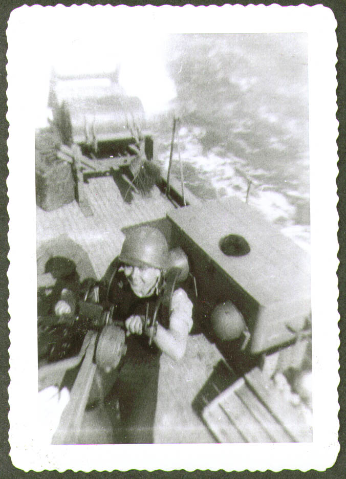 Crewman helmet at gun position USCG CG-83465 photo 1944