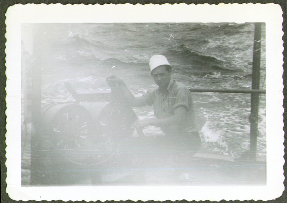 Sam Corey kneels at depth charges USCG CG-83465 1944