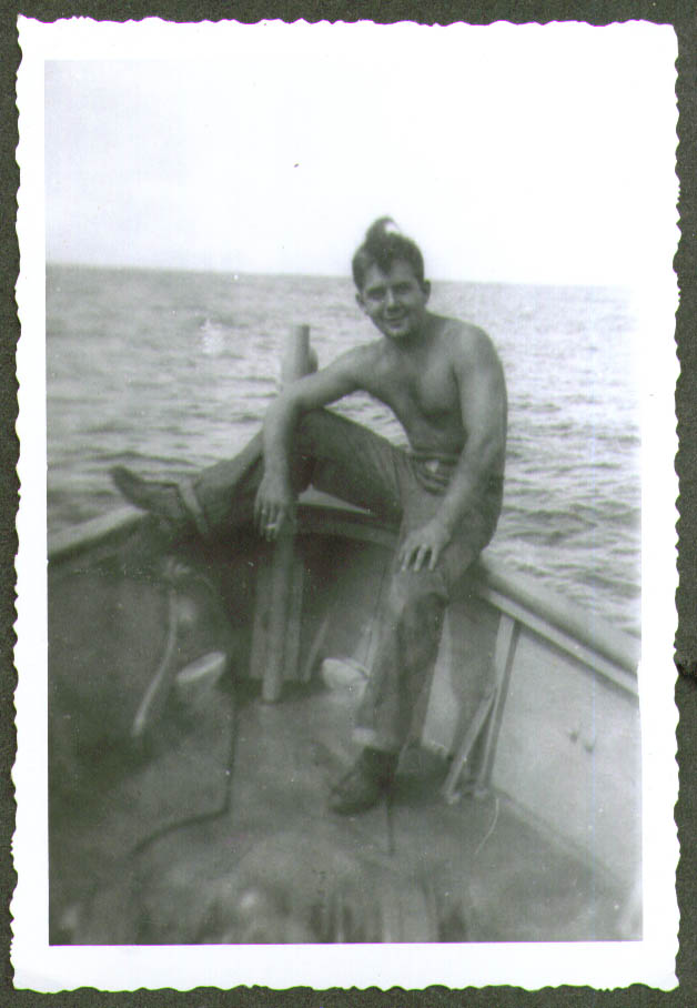 Crewman shirt off smokes fore USCG CG-83465 photo 1944
