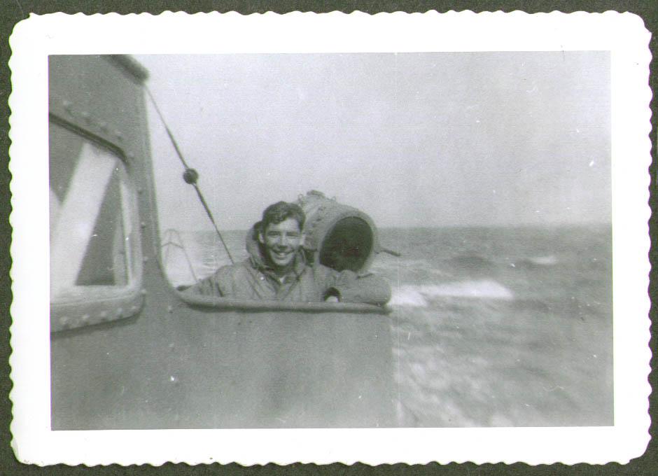 Crewman on bridge spotlight USCG CG-83465 photo 1944