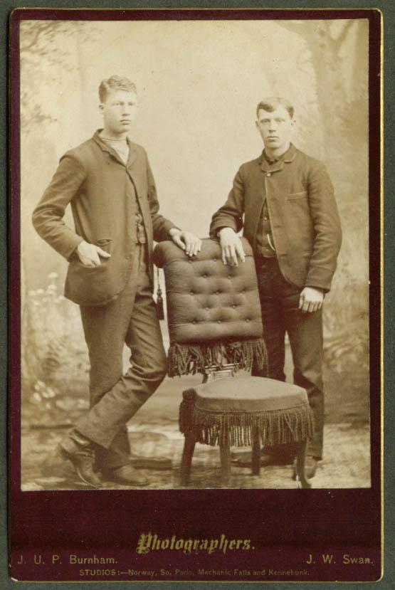 2 men plain suits chair cabinet Burnham & Swan ME