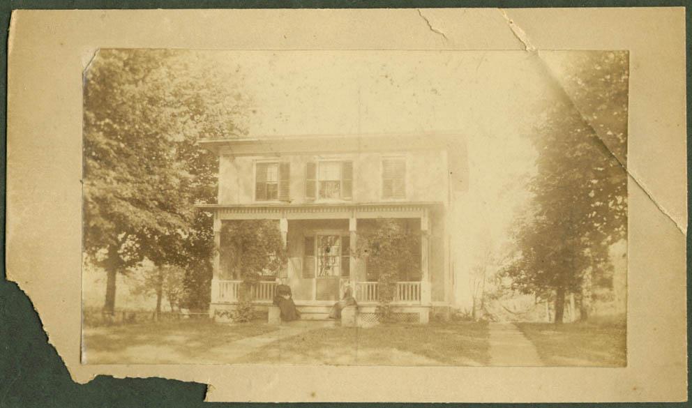 Sisson House S Main near Center Mrs Theo Lane on porch