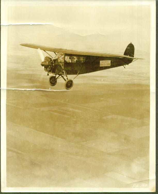 Des Moines Register Tribune monoplane in flight 1920s