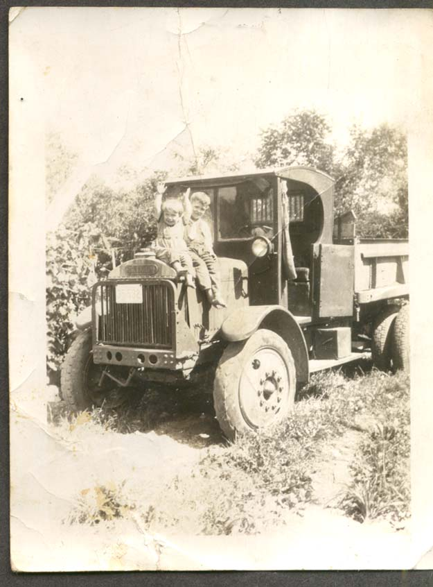 Boys playing on Brockway Dump Truck photo #1 ca 1930s