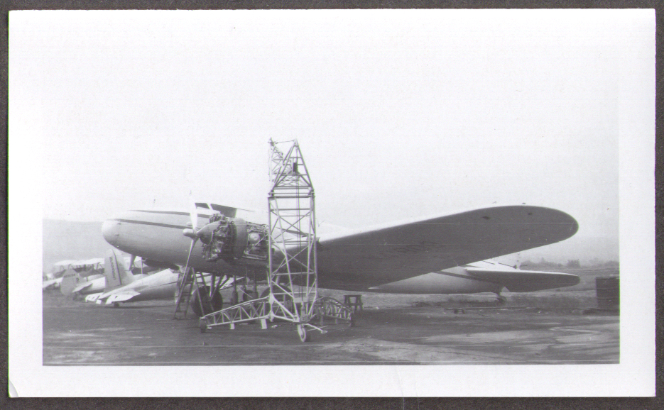 Boeing 247 airliner undergoing engine work photo no ID visible