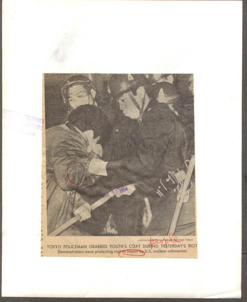 Japanese policeman vs Anti-Nuclear Demonstrators AP news photo 1964