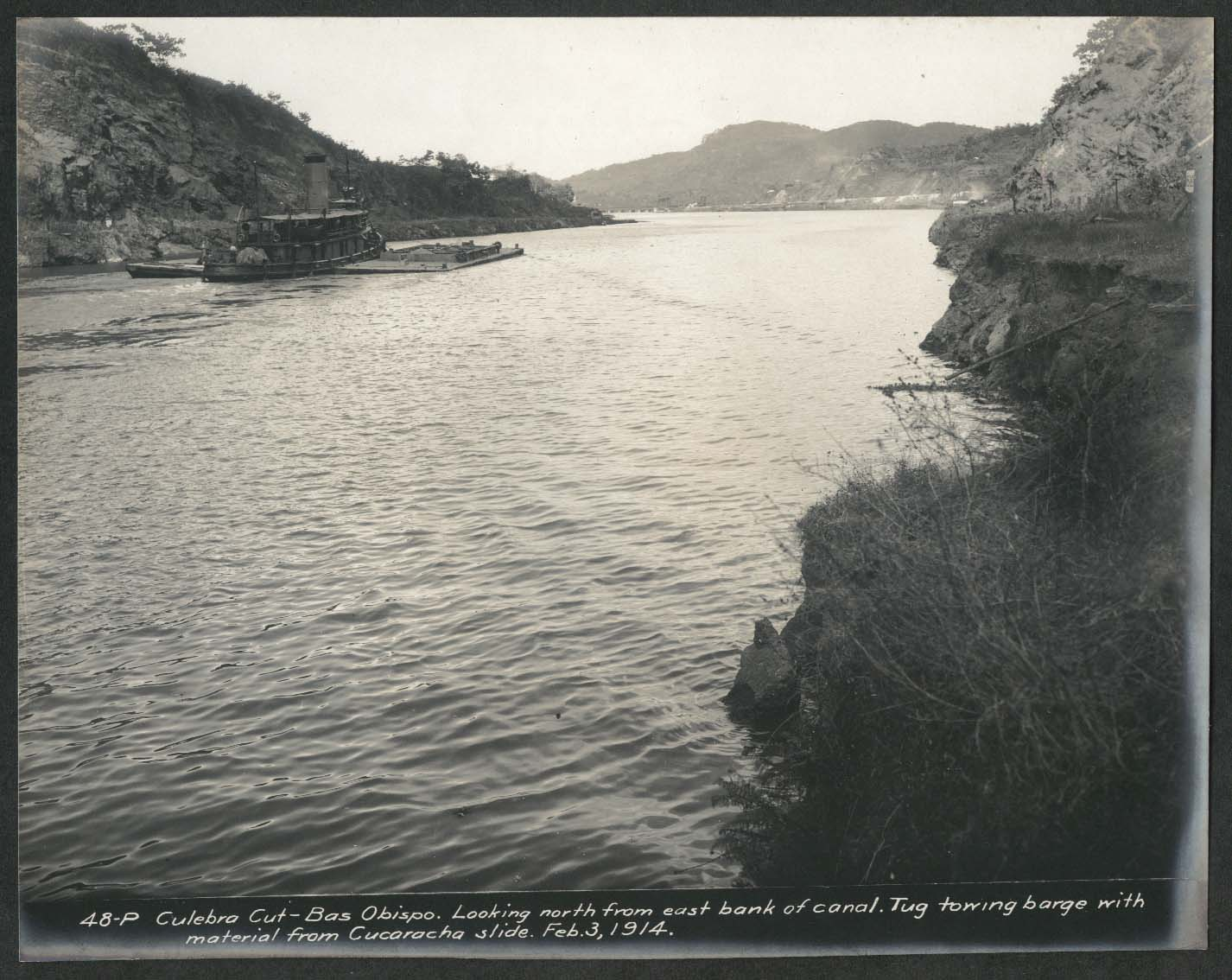 Image for Panama Canal photo 1914 Culebra Cut-Bas Obispo tug tows barge from Cucaracha