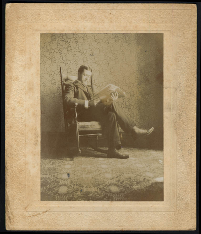 Image for Thomas Cordock in rocker reading newspaper photo 1/17 1897