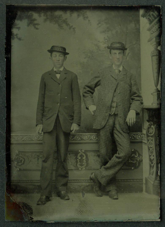 2 thin jug-eared men in straw hats studio tintype ca 1860s